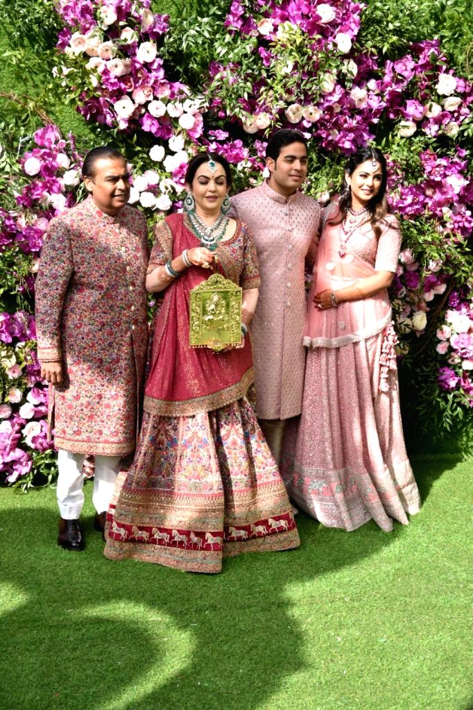 Industrialist Mukesh Ambani, Nita Ambani, Esha Ambani and Akash Ambani during wedding festivities of Akash Ambani and Shloka Mehta in Mumbai on March 9, 2019. - Mukesh Ambani, Nita Ambani, Esha Ambani, Akash Ambani and Shloka Mehta