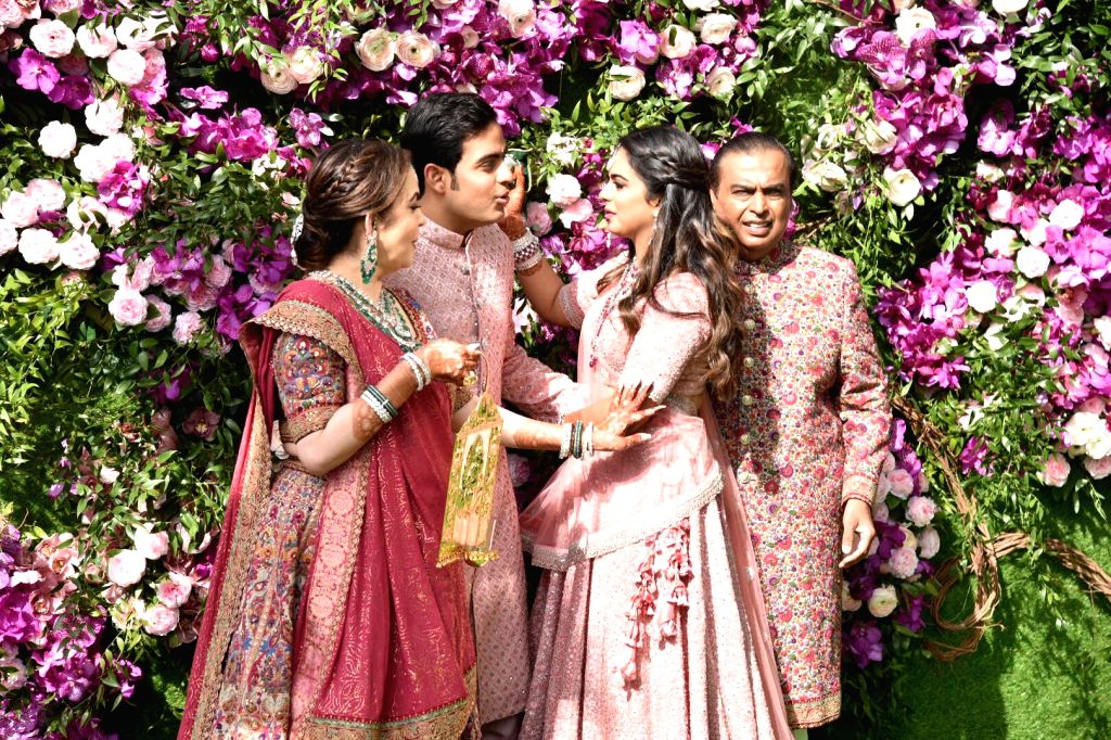 Industrialist Mukesh Ambani, Nita Ambani, Esha Ambani, Akash Ambani, during wedding festivities of Akash Ambani and Shloka Mehta in Mumbai on March 9, 2019. - Mukesh Ambani, Nita Ambani, Esha Ambani, Akash Ambani and Shloka Mehta