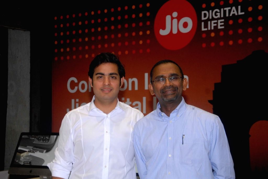 Industrialist Mukesh Ambani's son, Akash Ambani with Reliance Jio President Mathew Oommen at the launch of  i-Phone 7 with Relience JIO subscription in Mumbai, on Oct 7, 2016. - Mukesh Ambani and Akash Ambani