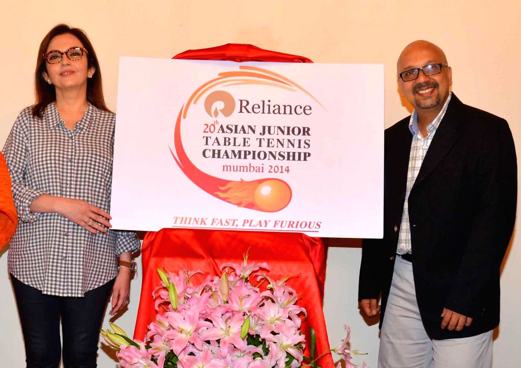 Industrialist Nita Ambani unveils the logo of the Asian Junior Table Tennis Championship in Mumbai on Sept 10, 2014. Also seen Chairperson of AJTTC Vita Dani, Tournament Advisor Niraj Bajaj and ... - Nita Ambani and Kamlesh Mehta