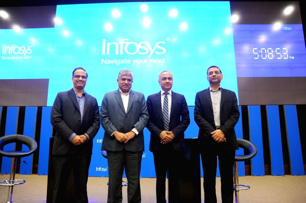 Infosys Chairman Nandan Nilkeni, CEO Salil Parkesh, COO Pravin Rao and CFO Nilanjan Roy during the press conference to announce the company third quarter results, in Bengaluru on Jan 10, ... - Pravin Rao and Nilanjan Roy
