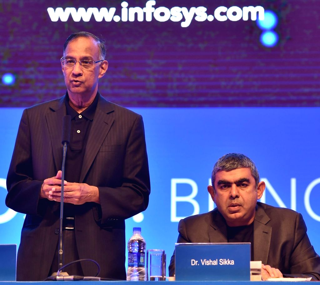 Infosys Chairman R Seshasayee addresses during the Infosys AGM in Bengaluru on June 18, 2016. Also seen Infosys CEO Vishal Sikka.