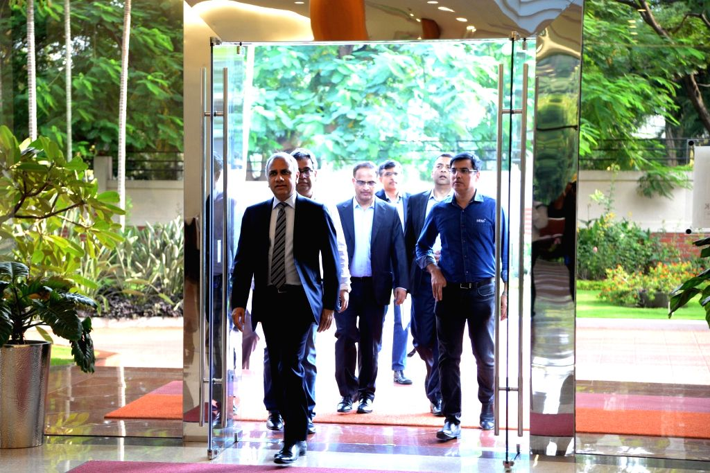 Infosys COO U B Pravin Rao, CEO Salil Parekh and CFO Nilanjan Roy arrive for a press conference organised to announce the company's second quarter (Q2) results for the fiscal year 2019-20, ... - Nilanjan Roy