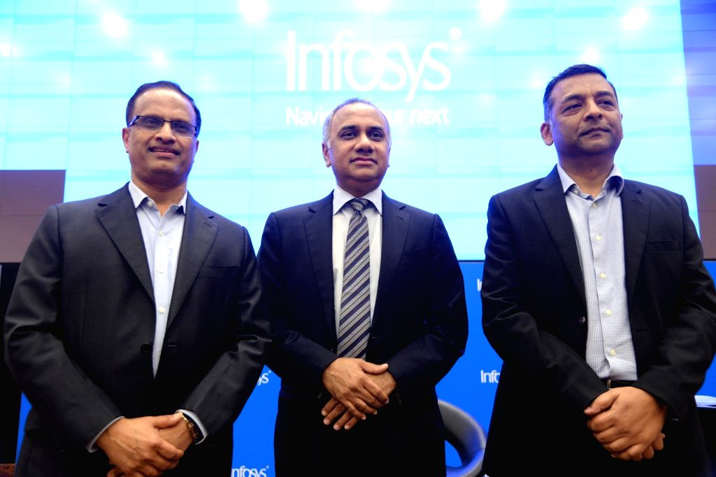 Infosys COO U B Pravin Rao, CEO Salil Parekh and CFO Nilanjan Roy during a press conference to announce the company's second quarter (Q2) results for the fiscal year 2019-20, in Bengaluru ... - Nilanjan Roy
