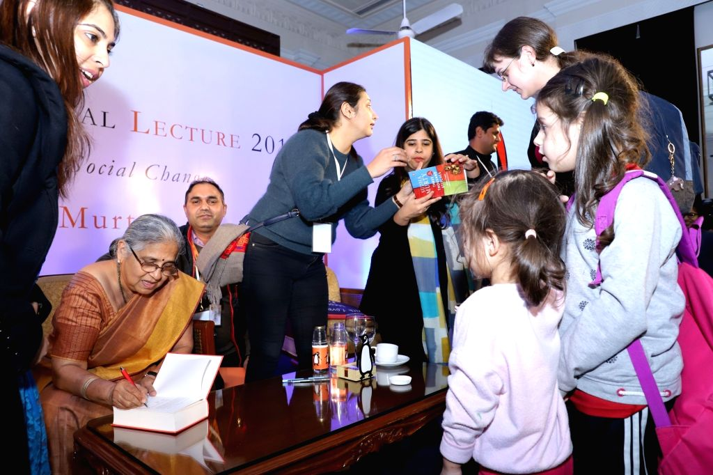 Infosys Foundation Chairperson Sudha Murthy autographing books during a master class on writing for kids and philanthropy at Penguin Annual Lecture 2019 on 'Storytelling and Social ...