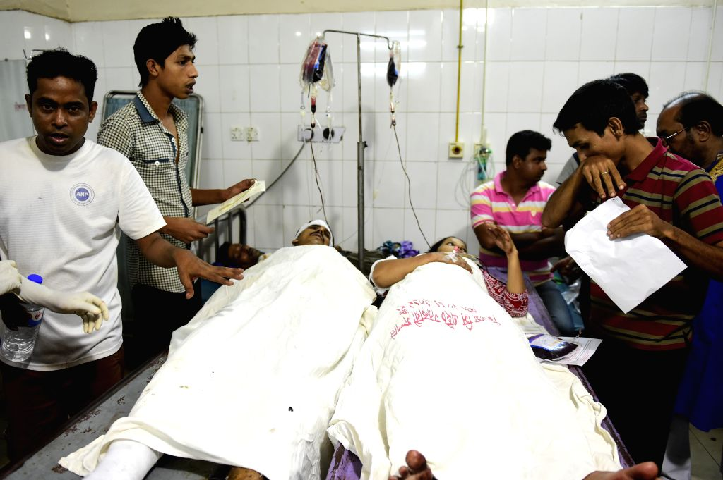 Injured Shiite Muslims receive treatment at Dhaka Medical Hospital after bomb attacks in Dhaka, Bangladesh, Oct. 24, 2015. Bomb attacks on a shrine killed at least ...