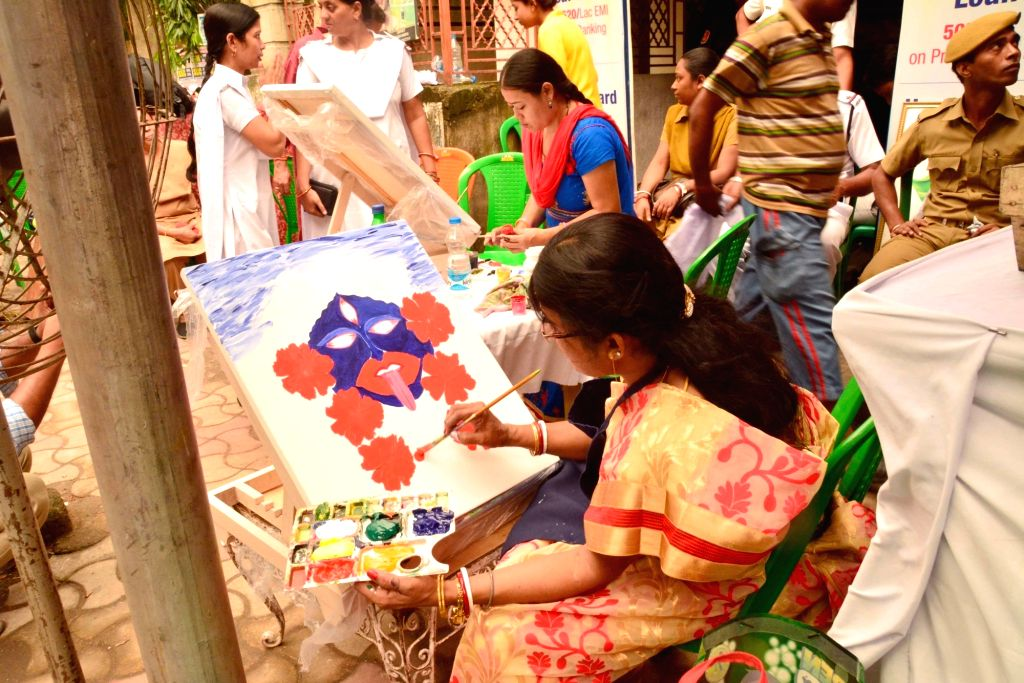 Inmates of various correctional homes paint pictures of goddess Kali ahead of Kali Puja in Kolkata on Oct 27, 2016.