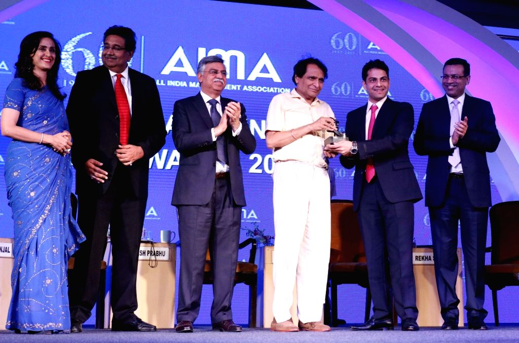 Inox Wind Ltd Founder and Executive Director Devansh Jain receives Young Entrepreneur award from Union Railway Minister Suresh Prabhu at the AIMA Awards ceremony in New Delhi, on April 27, ... - Suresh Prabhu and Devansh Jain
