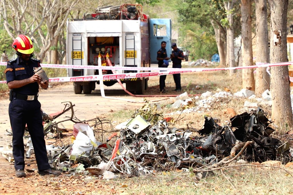 Inspection underway at the site where Hawk MK 132 aircraft of Indian Air Force's Surya Kiran display team crashed after a mid-air collision while rehearsing for upcoming  'Aero India 2019' ...