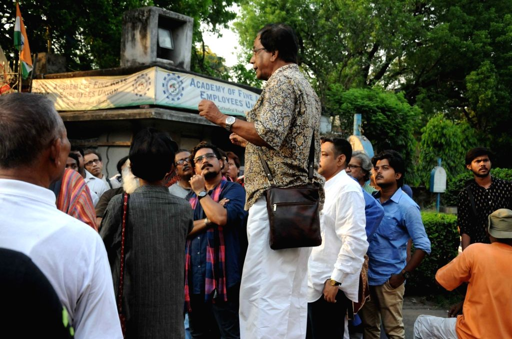 Intellectuals stage a demonstration at Academy of Fine Arts  to protest against the stopping exhibition of Sanatan Dinda's work in Kolkata on April 15, 2016.