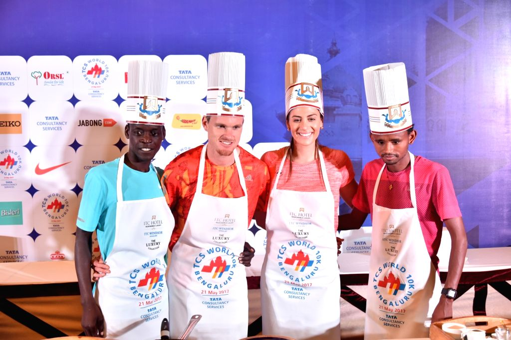 International athletes Zane Robertson, Stephanie Rice and others participate during a pasta cooking party in Bengaluru on May 20, 2017.