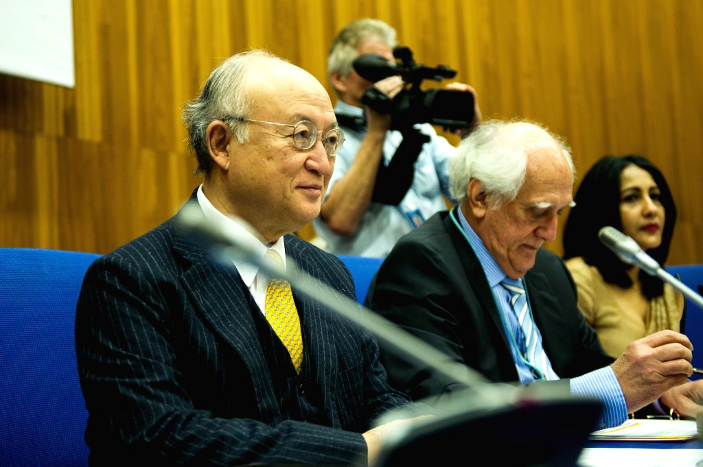 International Atomic Energy Agency's (IAEA) Director-General Yukiya Amano (front L) and rotating chairman of the IAEA board of governors, also Brazilian envoy to ...