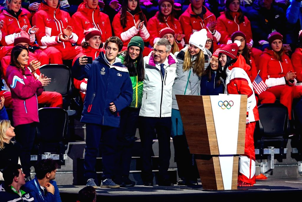 International Olympic Committee (IOC) President Thomas Bach (front C) takes selfies with athletes during the opening ceremony of the 3rd Winter Youth Olympic Games ...