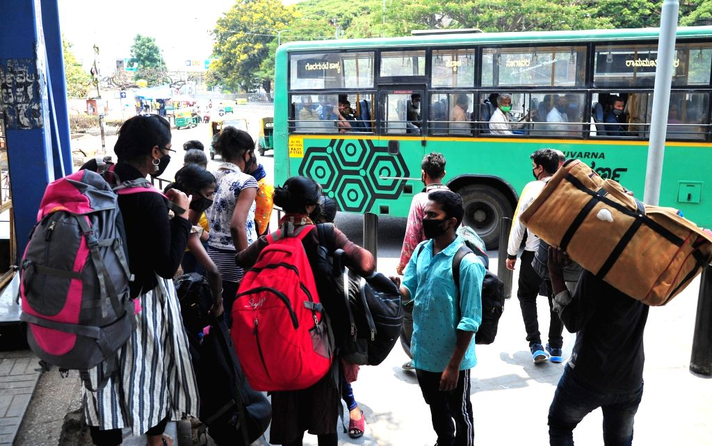 Interstate (migrant) workers at Majestic bus stand to travel to their native places due to surge in covid-19 during Coronavirus pandemic, in Bengaluru on Sunday 18th April 2021
