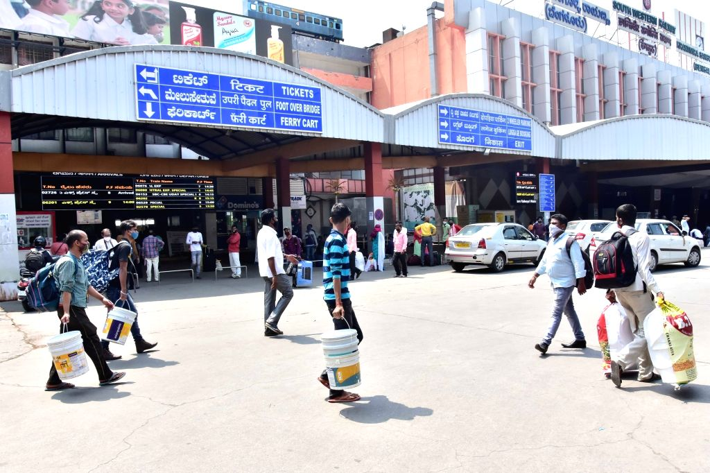 Interstate (migrant) workers gathered at Bengaluru City Railway station to travel to their native places due to surge in covid-19 during Coronavirus pandemic, in Bengaluru On Friday, 16th ...