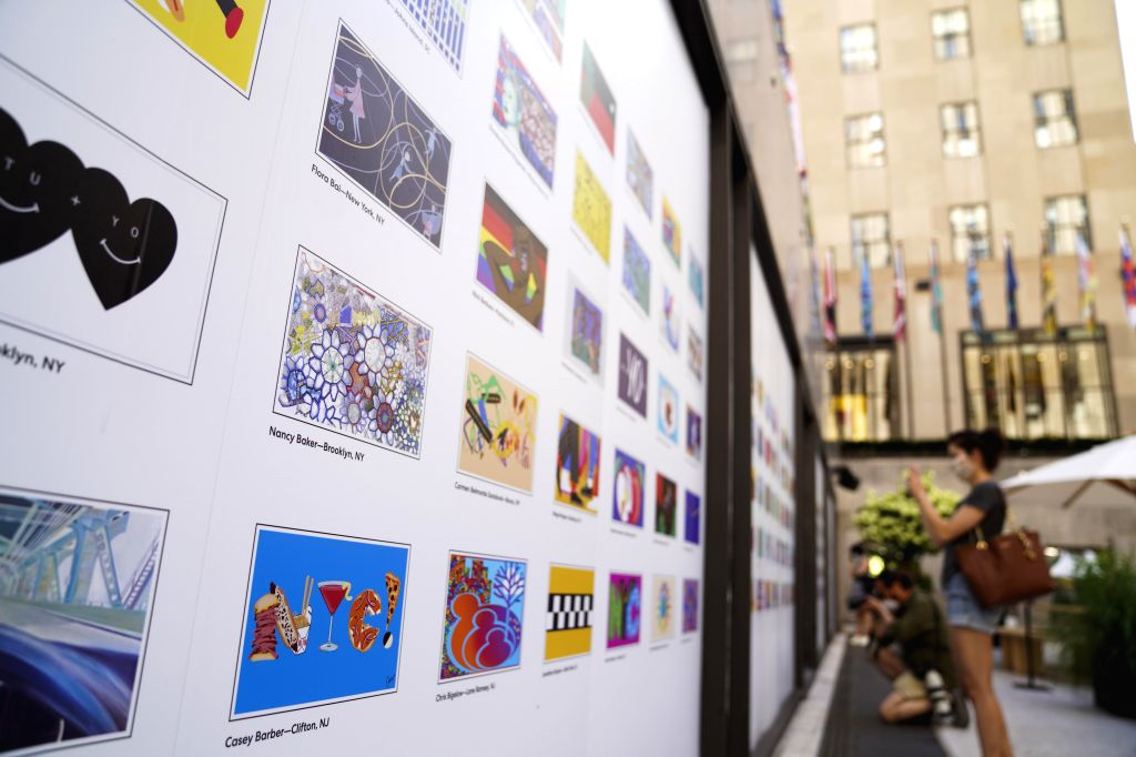 """Introductions of flag designs of """"the Flag Project"""" are seen in the rink of the Rockefeller Center in New York, the United States, August 1, 2020. The ..."""
