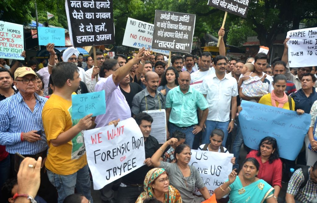 Investors in Jaypee's Wish Town project stage a protest at Jantar Mantar, in New Delhi on Aug 19, 2017.