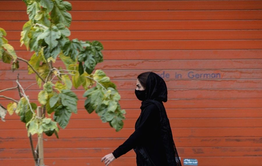 Iran, Nov. 16  A woman wearing a face mask walks past a closed shop in Mashhad, Iran, Nov. 16, 2020.