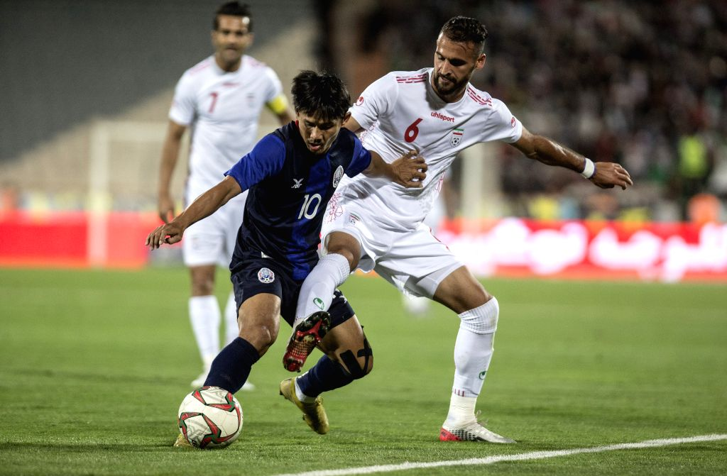 IRAN, Oct. 11, 2019 - Ahmad Nourollahi (R) of Iran vies with Kouch Sokumpheak of Cambodia during the FIFA World Cup Qatar 2022 Qualification match between Iran and Cambodia at Azadi Stadium in ...