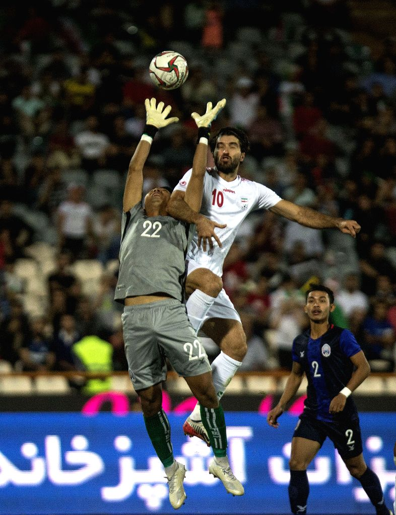 IRAN, Oct. 11, 2019 - Karim Ansarifard (top R) of Iran vies for the ball during the FIFA World Cup Qatar 2022 Qualification match between Iran and Cambodia at Azadi Stadium in Tehran, Iran, Oct. 10, ...