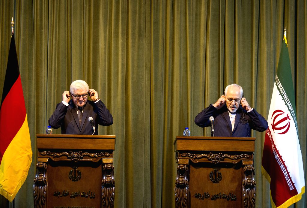 Iran's Foreign Minister Mohammad-Javad Zarif (R) and his German counterpart Frank-Walter Steinmeier attend a joint press conference in Tehran, Iran, on Oct. 17, ... - Mohammad-Javad Zarif