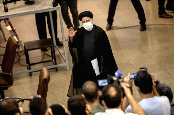 Iran's Judiciary Chief Ebrahim Raisi arrives to register his candidacy for presidential race at the Interior Ministry in Tehran, Iran, May 15, 2021.