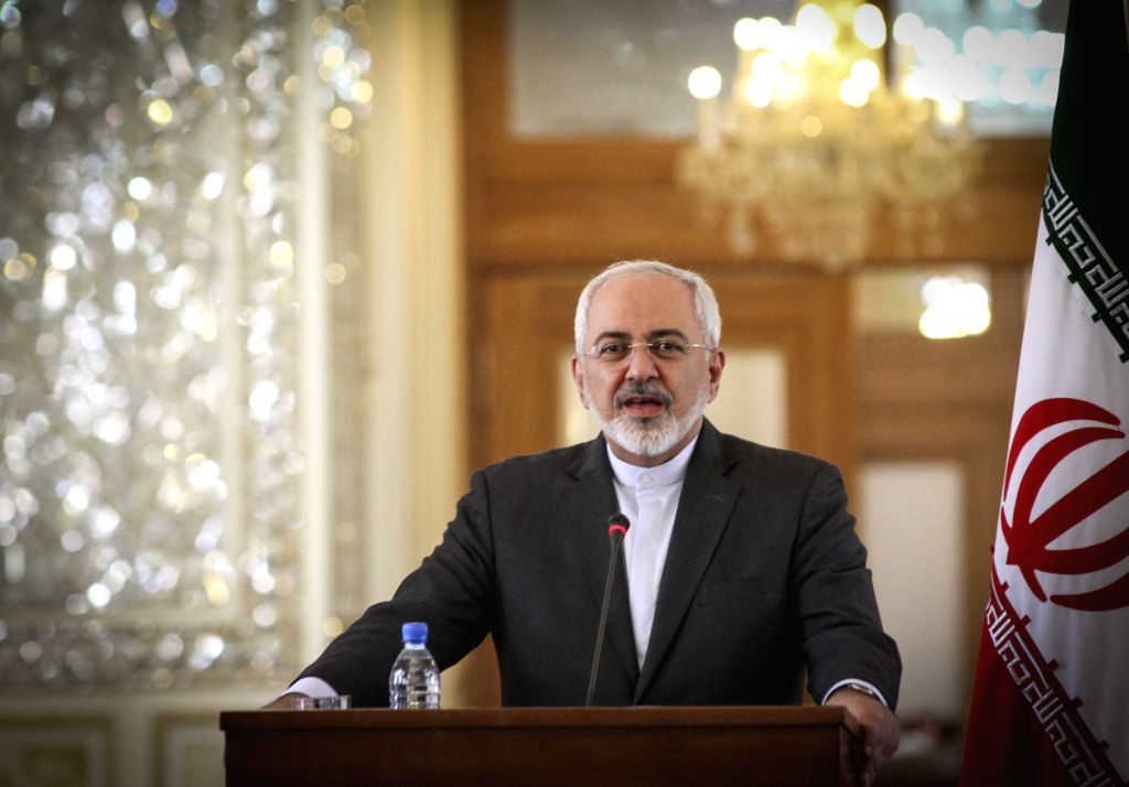 Iranian Foreign Minister Mohammad-Javad Zarif speaks during a joint press conference with his French counterpart Laurent Fabius after their meeting in Tehran, Iran, ... - Mohammad-Javad Zarif