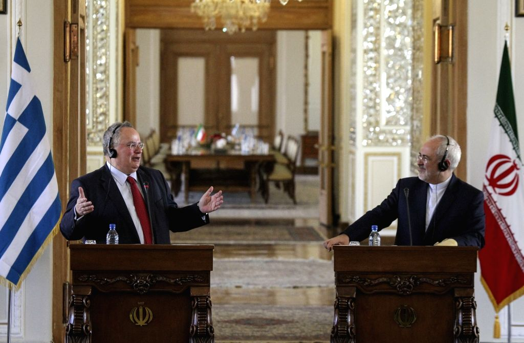 Iranian Foreign Minister Mohammad-Javad Zarif (R) and his Greek counterpart Nikos Kotzias Didier Reynders attend a joint press conference after their meeting in ... - Mohammad-Javad Zarif