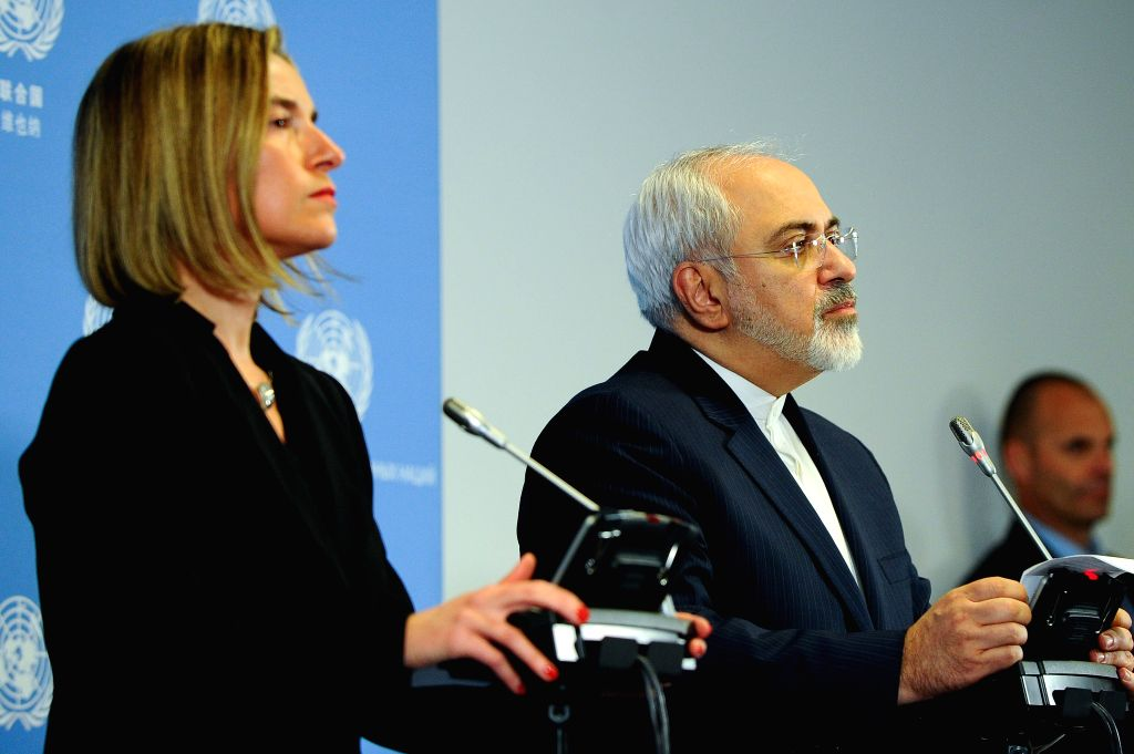 Iranian Foreign Minister Mohammad Javad Zarif(R) and EU foreign policy chief Federica Mogherini  attend a press conference in Vienna, Austria, Jan. 16, 2016. The ... - Mohammad Javad Zarif