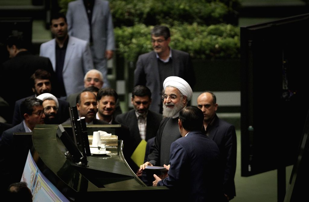 Iranian President Hassan Rouhani (3rd R) attends a session at the parliament in Tehran Jan. 17, 2016. Iran's President Hassan Rouhani on Sunday presented the ... - Hassan Rouhani