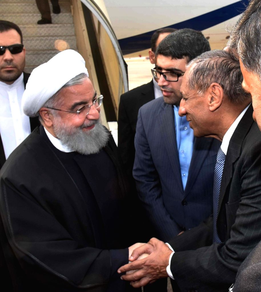 Iranian President Hassan Rouhani being recived by Telangana Governor E.S.L. Narasimhan at Begumpet Airport in Hyderabad on Feb 15, 2018. - Hassan Rouhani