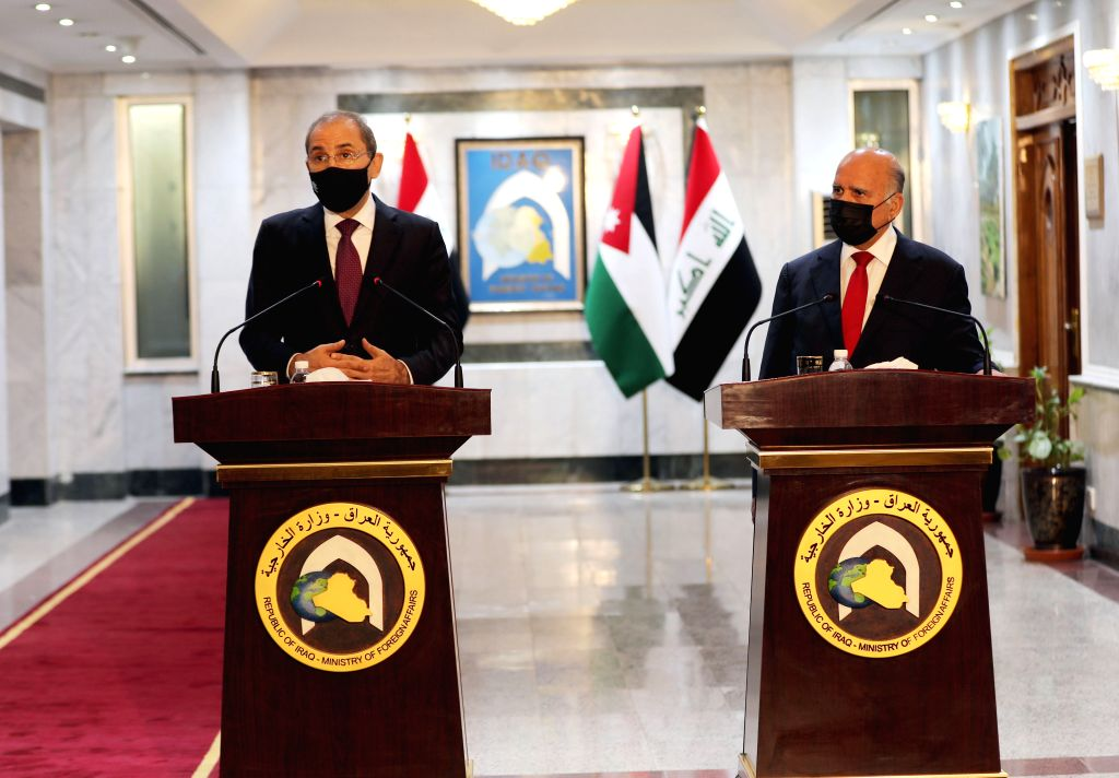 Iraqi Foreign Minister Fuad Hussein (R) and Jordanian Foreign Minister Ayman Safadi attend a press conference in Baghdad, Iraq, on June 24, 2020. Ayman Safadi on ... - Fuad Hussein