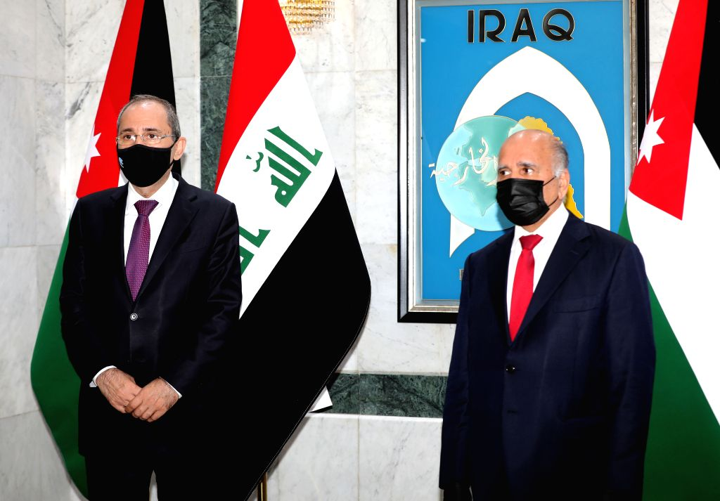 Iraqi Foreign Minister Fuad Hussein (R) meets with Jordanian Foreign Minister Ayman Safadi in Baghdad, Iraq, on June 24, 2020. Ayman Safadi on Wednesday held talks ... - Fuad Hussein