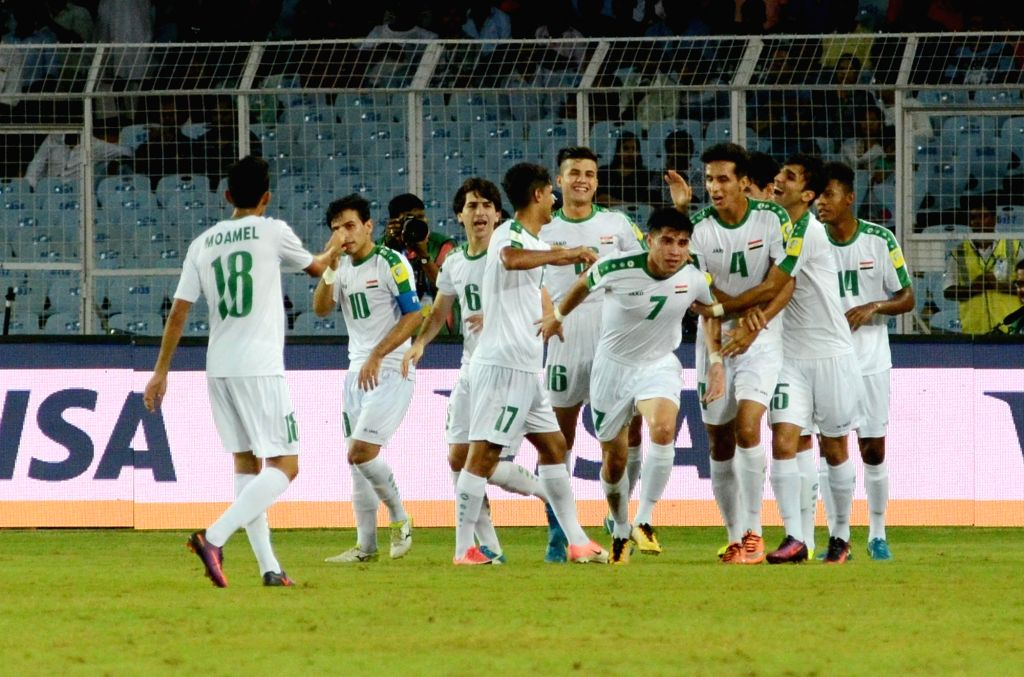 Iraqi players celebrate a goal during ​a FIFA U17 World Cup India 2017 Group F match between Iraq and Chile at Salt Lake Stadium in Kolkata on Oct 11, 2017.