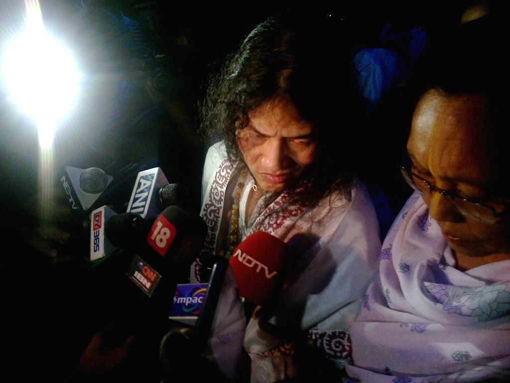 """Irom Sharmila talks to the media as she walks free after being released from hospital in Imphal on Aug 20, 2014. Sharmila, 42, better known as the """"Iron Lady"""", has been on an indefinite ..."""