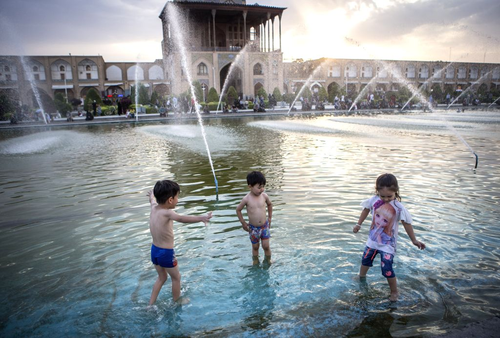 ISFAHAN, July 17, 2019 - Children cool themselves off in the water on a hot day in Isfahan, Iran, July 16, 2019.