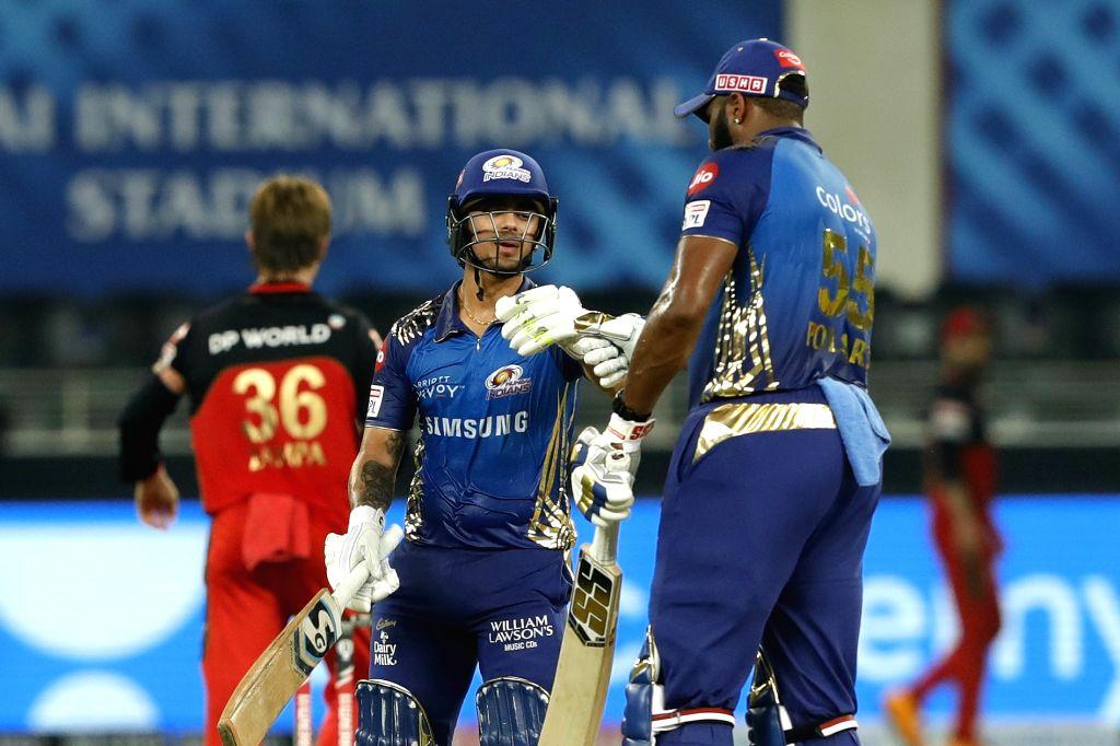 Ishan Kishan of Mumbai Indians and Kieron Pollard of Mumbai Indians during match 10 of season 13 of the Dream 11 Indian Premier League (IPL) between The Royal Challengers Bangalore and The ...
