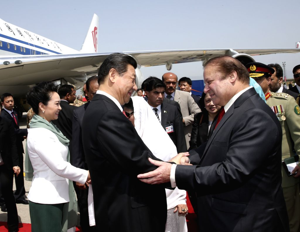 Chinese President Xi Jinping (L, front) is welcomed by Pakistani Prime Minister Nawaz Sharif upon his arrival in Islamabad, Pakistan, April 20, 2015. Xi is on a ... - Nawaz Sharif