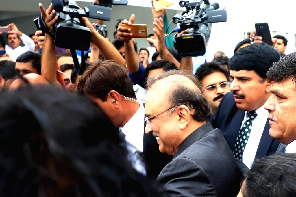 ISLAMABAD, Aug. 13, 2018 (Xinhua) -- Pakistan Peoples Party's (PPP) Co-Chairperson and former President Asif Ali Zardari leaves the National Assembly after attending the first session of the parliament after the general election, in Islamabad, capita