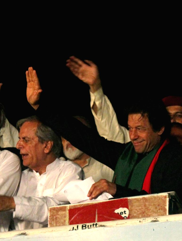 Pakistani opposition politician, cricketer-turned politician Imran Khan (R) gestures as he attends a protest in front of Parliament in Islamabad, capital of ... - Nawaz Sharif