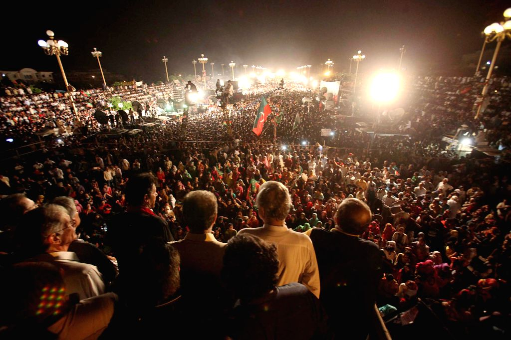 Supporters of opposition politician, cricketer-turned politician Imran Khan, attend a protest in front of Parliament in Islamabad, capital of Pakistan on Aug. 20, - Nawaz Sharif