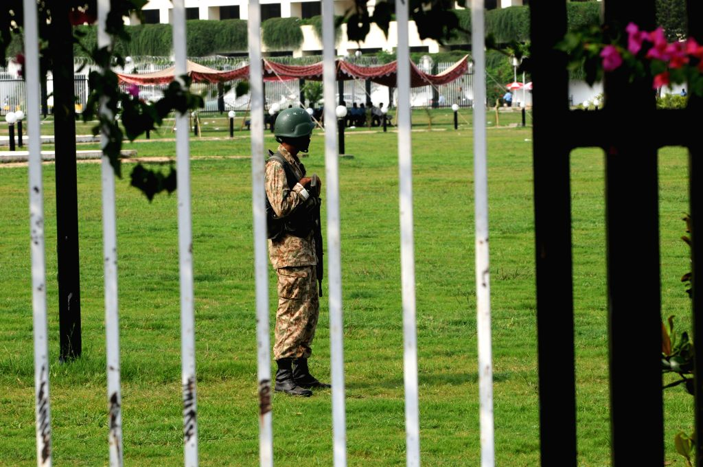 A Pakistani soldier stands guard outside the parliament building during a protest in Islamabad, capital of Pakistan, Aug. 21, 2014. Pakistani parliament on ... - Nawaz Sharif