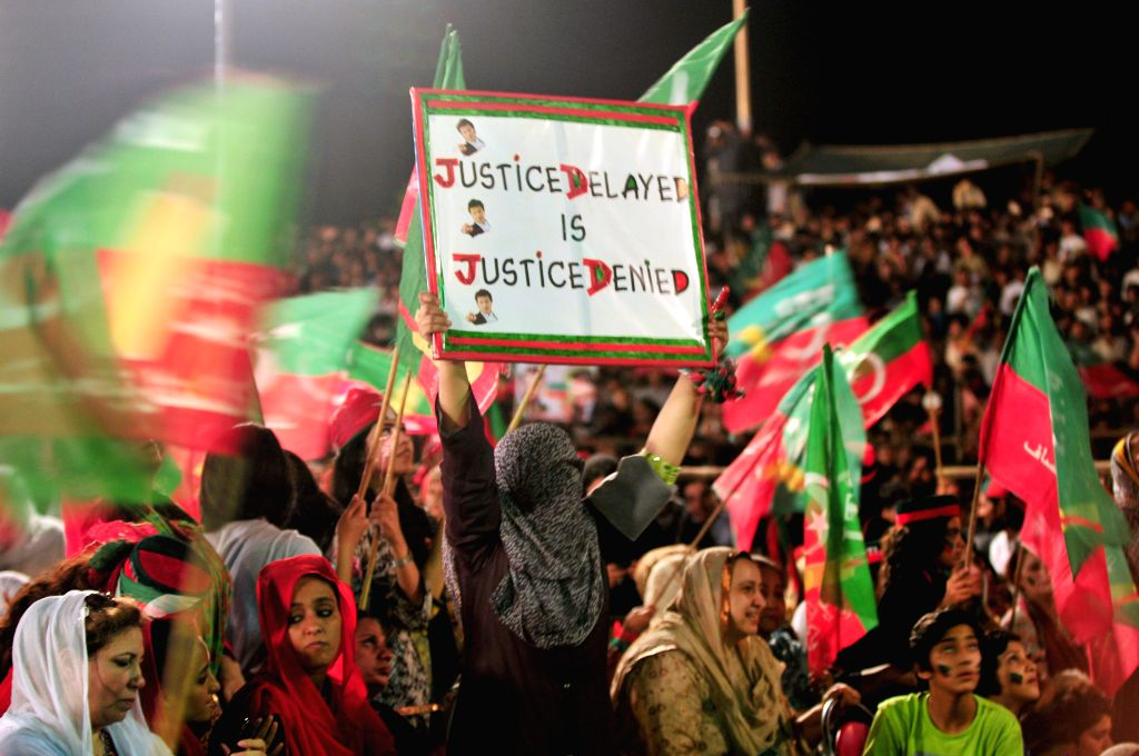 Supporters of opposition leader Imran Khan gather during an anti-government protest in front of the Parliament in Islamabad, capital of Pakistan on Aug. 22, 2014.