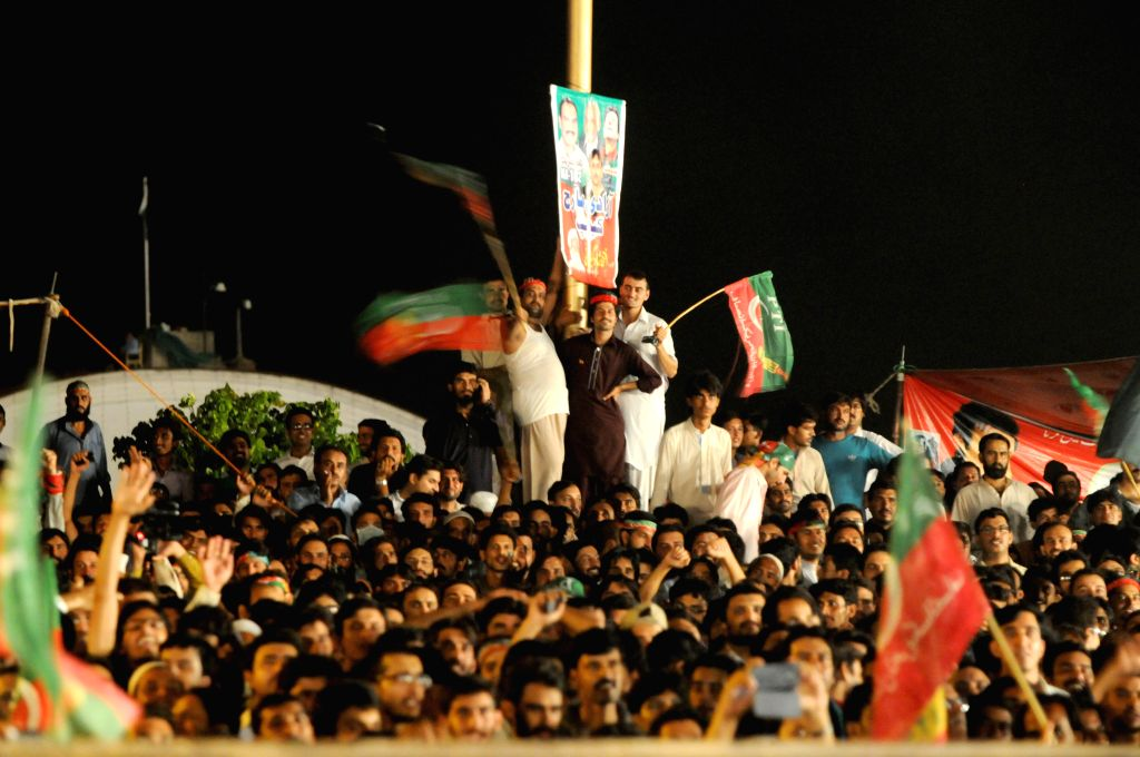Supporters of opposition leader Imran Khan gather during an anti-government protest in front of the Parliament building in Islamabad, capital of Pakistan, on Aug.
