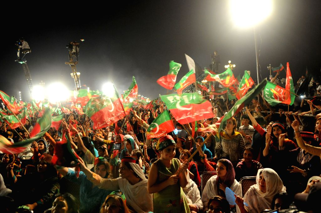 Pakistani supporters of opposition politician Imran Khan gather during an anti-government protest in front of the Parliament in Islamabad, capital of Pakistan, on