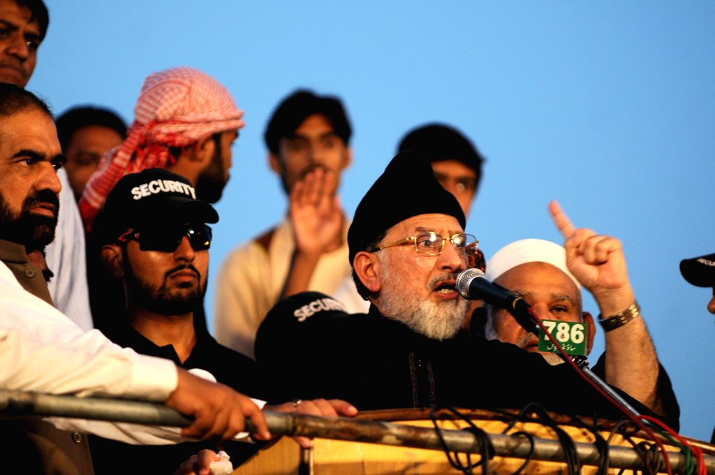 Religious leader Tahir-ul-Qadri speaks to supporters during an anti-government protest in front of the parliament building in Islamabad, capital of Pakistan, on .. - Nawaz Sharif