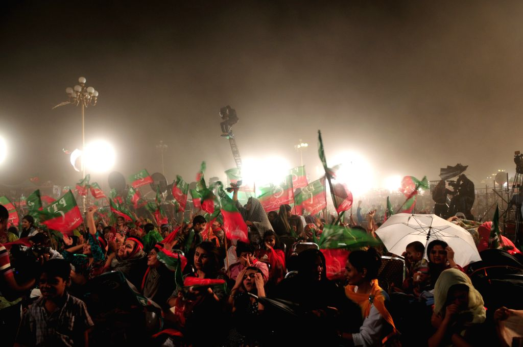 Supporters of Imran Khan, head of opposition political party Pakistan Tehrik-e-Insaf, gathered during an anti-government protest for the 12th day in Islamabad, ... - Imran Khan