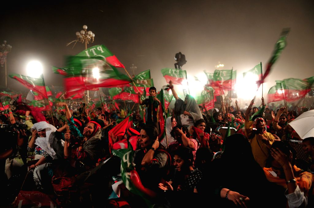 Supporters of Imran Khan, head of opposition political party Pakistan Tehrik-e-Insaf, gather during an anti-government protest for the 12th day in Islamabad, ...