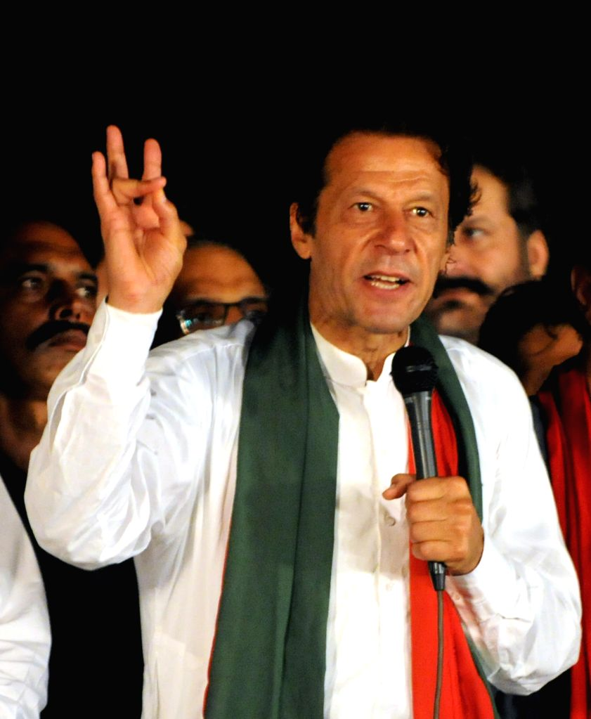Pakistani opposition politician Imran Khan speaks to his supporters during an anti-government protest in front of the parliament building in Islamabad, capital of - Nawaz Sharif Wednesday and Imran Khan