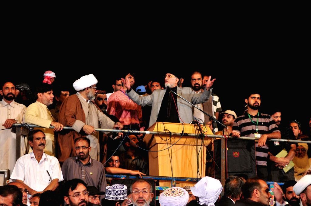 Religious leader Tahir-ul-Qadri speaks to supporters during an anti-government protest in front of the parliament building in Islamabad, capital of Pakistan, on .. - Nawaz Sharif Wednesday